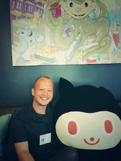 Fig. 4: Cuddling on the GitHub HQ 2.0 couch with the Octocat.